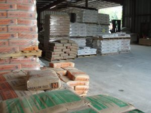 pallets of bagged cement and mortar